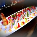 Red Eye Roll - A dynamite Roll (tempura Prawn Avacado and tempura bits) topped with our Fresh Tuna spicy mayo hot sauce and green onions! an all time favorite!